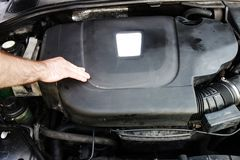 Worker check diesel car motor royalty free stock photo
