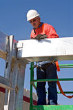 Worker Checking Angles. Construction worker checking the angles of steel beam or girder Stock Image