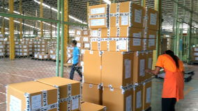 Worker checking finished goods carton. stock footage