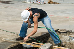 Worker Checking Placement Royalty Free Stock Photo