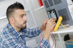 Worker checking quality processed tool using precise device Royalty Free Stock Photo