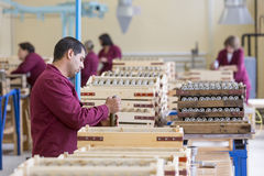 Worker checking RPG explosives in munition factory Royalty Free Stock Image