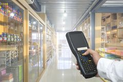 Worker checking and scanning package by tablet handheld in warehouse, Selective focus. Worker checking and scanning package by tablet handheld in warehouse Stock Image