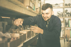 Worker checking small details for sanitary engineering in worksh Royalty Free Stock Photos