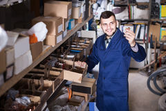 Worker checking small details for sanitary engineering in worksh Royalty Free Stock Image
