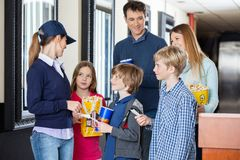 Worker Checking Tickets Of Family At Cinema Royalty Free Stock Photography