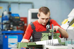 Worker checking tool with optical device Royalty Free Stock Photos