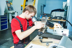 Worker checking tool with optical device Stock Images