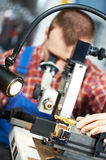 Worker checking tool with optical device Royalty Free Stock Images