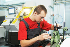 Worker checking tool with optical device Stock Photos