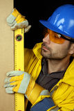 Worker checking vertical level Stock Photos