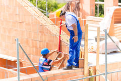 Worker checking walls on construction site Royalty Free Stock Image