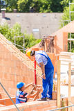 Worker checking walls on construction site Stock Photography