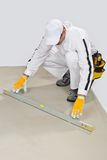 Worker checks cement base levels Royalty Free Stock Photos