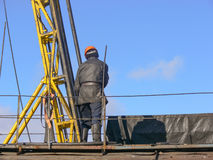 Worker checks the equipment on the rig for coring Stock Image