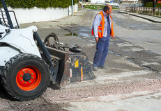 Worker checks the progress of the Milling of asphalt Royalty Free Stock Photos