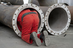 Worker checks a steel pipe Royalty Free Stock Photo