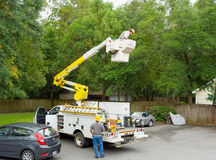 A worker in a cherry picker Royalty Free Stock Images