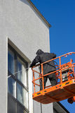 Worker in cherry-piker. Washing A building exterior Stock Photos