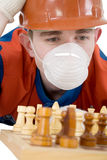 Worker and chess Stock Image