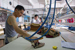 Worker in a chinese garment factory Stock Photography