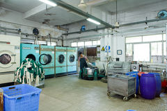 Worker in a chinese garment factory Royalty Free Stock Photography