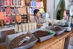 Worker in a chocolate and mole shop selling chocolate in Oaxaca stock image