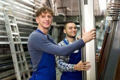 Worker choosing PVC window profile Royalty Free Stock Image