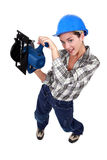 Worker with a circular saw. Stock Images