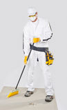 Worker clean cement base with broom stock photo
