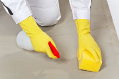 Worker clean cement substrate with sponge Stock Photo