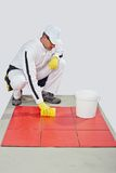 Worker clean red tiles Royalty Free Stock Photos