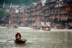 Worker clean up the river in Fenghuang ancient city. Stock Image