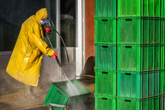Worker Cleaning Boxes Stock Image