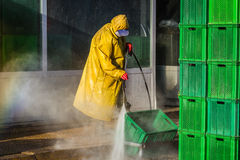 Worker Cleaning Boxes Stock Images