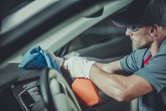 Worker Cleaning Car Interior stock photography
