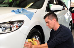 Worker cleaning a car. Royalty Free Stock Photo
