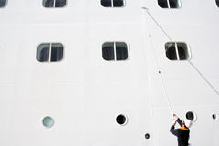 Worker Cleaning a cruise ship Stock Image