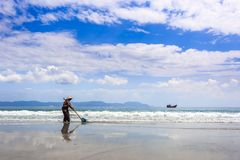 Worker Cleaning Doc Let Beach, Vietnam Royalty Free Stock Photos