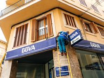 Worker cleaning the facade of the Spanish BBVA Royalty Free Stock Image