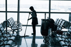 Worker cleaning the floor at the airport Royalty Free Stock Photography