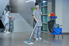 Worker cleaning floor with machine stock images