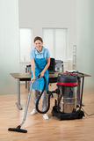 Worker Cleaning Floor With Vacuum Cleaner Royalty Free Stock Photo
