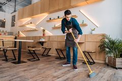 Free Worker Cleaning Floor With Sweep Stock Photo - 103937960