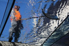 Worker cleaning glass Royalty Free Stock Photo