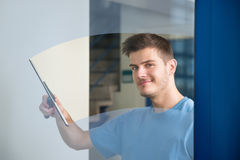 Worker Cleaning Glass With Squeegee Stock Photos