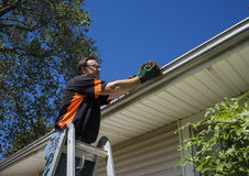 Worker Cleaning Gutters Royalty Free Stock Images