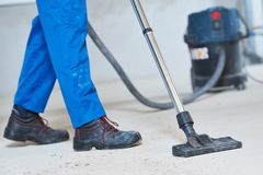 Building cleaning service. dust removal with vacuum cleaner royalty free stock photography