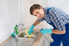 Worker Cleaning Sink In Kitchen Room Stock Images