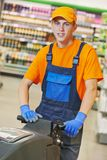 Worker cleaning store floor with machine Royalty Free Stock Photography